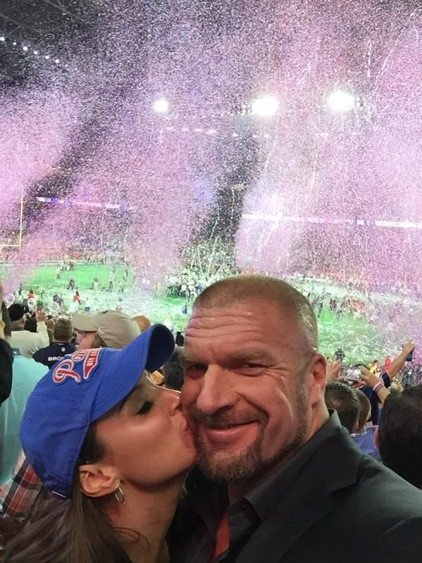 WWE legend Triple H (Paul Levesque) and his wife Stephanie McMahon share a kiss at the SuperBowl #WWE #WWEHOF #HHH #wwecouples #wwewives #wwewags
