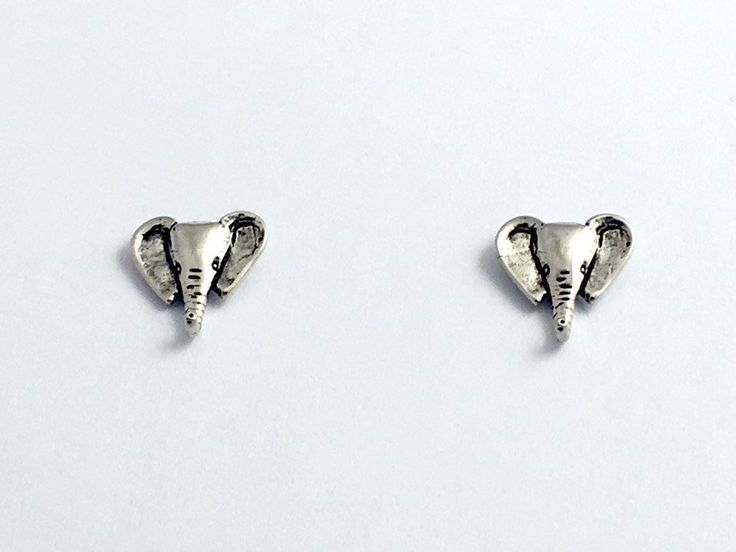 Sterling Silver and Surgical Steel elephant head stud earrings- elephants, This is a sweet pair of sterling silver and surgical steel elephant head stud earrings. These measure approx. 1/2 inch long,