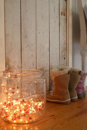 Christmas lights in a clear glass jar ...simple, effective way to light an entry way or bathroom during a party