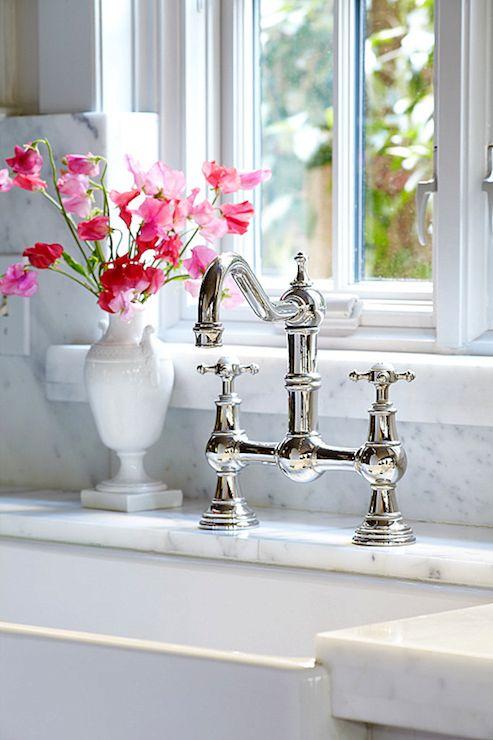 Suzie: Cote de Texas - Glam kitchen with white porcelain farmhouse sink, polished nickel bridge ...