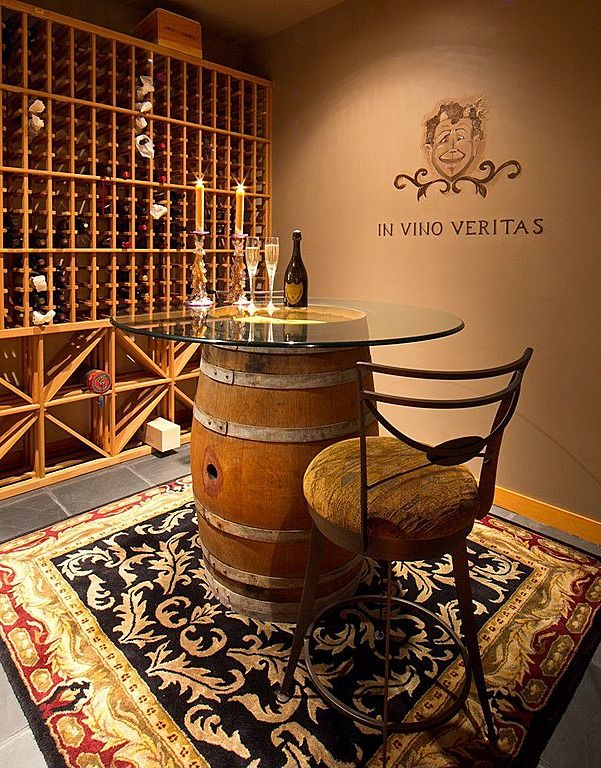 Not only is there an expansive amount of storage for pinots and chardonnays, this wine cellar allows you to sit, sip and savor.