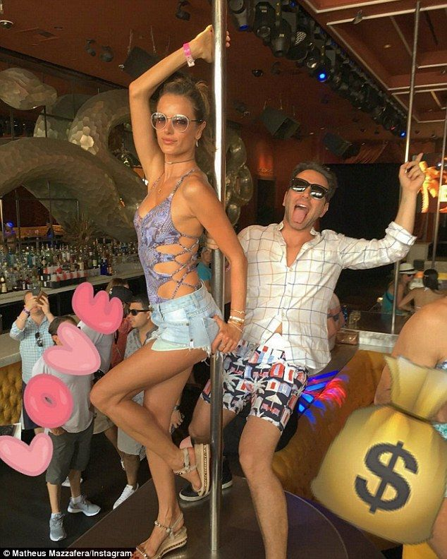 Brazilian bombshell! The Victoria's Secret Angel wore a sexy snakeskin swimsuit and Daisy Dukes while partying in Las Vegas with her 'bestie' - stylist and television personality Matheus Mazzafera, 34