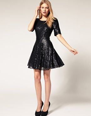 Sequin dress by Oasis. Featuring all over sequin embellishment, boat neckline, elongated short sleeve styling, fitted waist, a flared skater skirt, and an exposed zip fastening to reverse. Designed with a mini cut length. $139.66