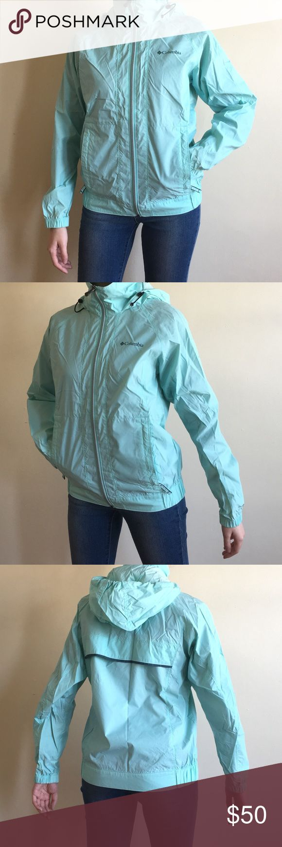 "Columbia Omni-Shield Aqua Packable Rain Jacket Columbia Sportswear Company Omni-Shield dark cyan aqua blue packable rain jacket. Great quality rain jacket. Thin & lightweight. Full zip. Zippered pockets. Ventilated mesh open back. Velcro behind the collar & hood so it can be folded and packed. Super convenient for throwing in your bag on those unsure rainy days. Womens size XS but can fit up to a size S. No holes but there are several marks. Worn. Used condition   Pit to pit: 18"" Pit to hem…"