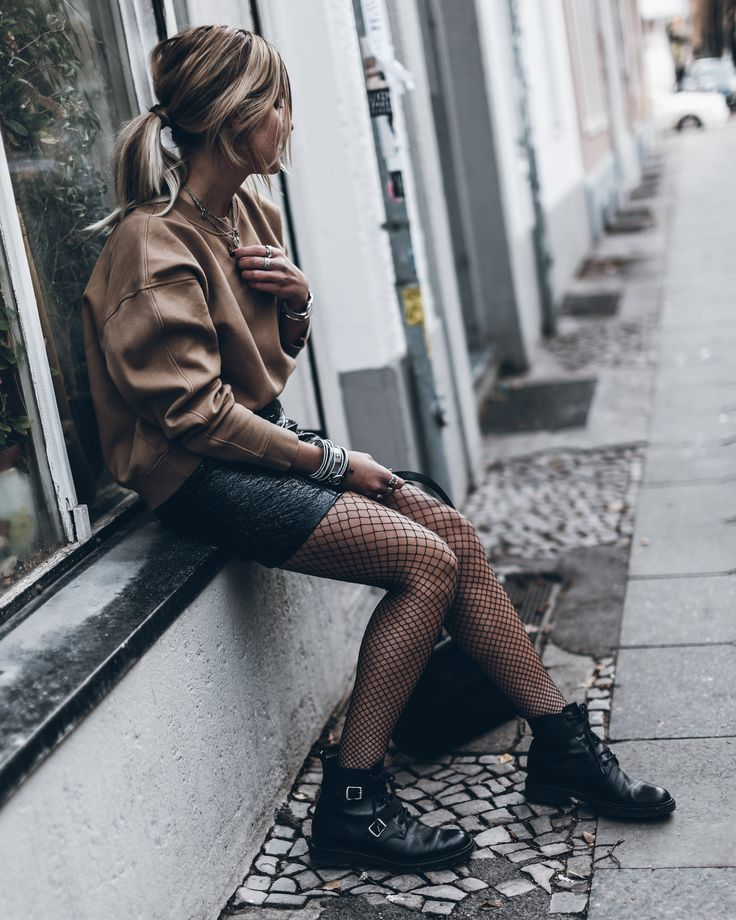 Patent Skirt and Fishnets. By the way, Fishnets Are Back: Here are 18 Chic Ways to Wear Them. | glitterinc.com | @glitterinc
