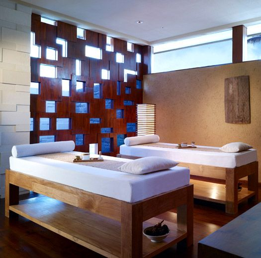 Such a clean and relaxing looking massage room