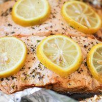 A tutorial on how to barbecue salmon in tin foil on a grill. This easy dinner can be prepared in just 15 minutes!