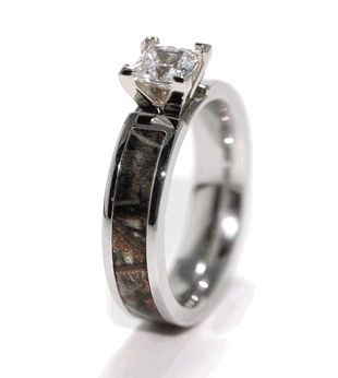 Camo Engagement Wedding ring. We are getting Camo rings for our anniversary one of these years!! :)