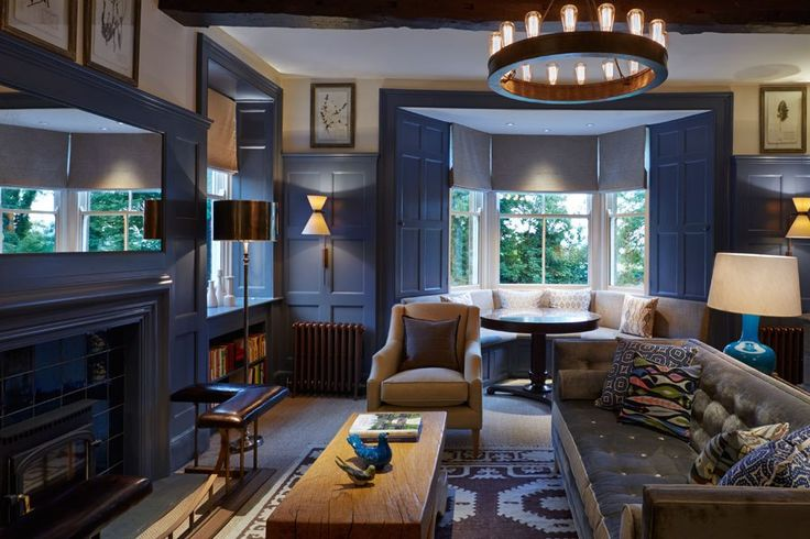 The UK's Dormy House Hotel Is Transformed into a Luxurious Country Retreat A blue paneled lounge is one of the hotel's handsome common areas.
