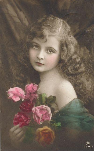 Beautiful vintage postcard of a girl