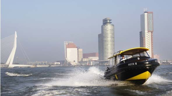 rotterdam water taxi With multiple boarding docks in the Rotterdam area the watertaxi is the perfect and fastest transportation to experience and travel in Rotterdam. The home base is located nearby Hotel New York where there is also a boarding dock for the watertaxi. Most of the watertaxis are steered by old sailors and can tell you a lot about the history of sailing around the globe and the harbor of Rotterdam. I use the watertaxi nearby the SS Rotterdam so we can get to the mainland.