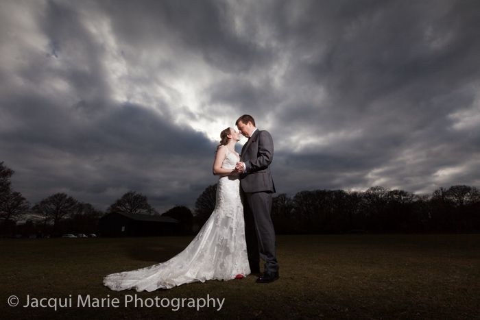 Bride and groom against a dramatic sky at the Balmer Lawn Hotel in the New Forest, photographed by Hampshire wedding photographers Jacqui Marie Photography. VISIT http://jacqui-marie-photography.co.uk for details.  #wedding #photography #weddingphotography #Hampshire #England #uk