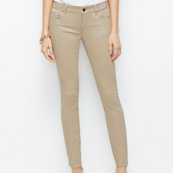 Ann Taylor Khaki Skinny Pants Cream khaki skinnies. Really cute. Goes with everything. Dress up or down. In new condition. No flaws. Ann Taylor Pants Skinny