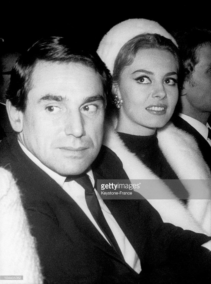 On December 9, 1964, athe cinema Moulin Rouge in Paris, French actors Michele MERCIER and her companion Robert HOSSEIN attending the screening of ANGELIQUE.
