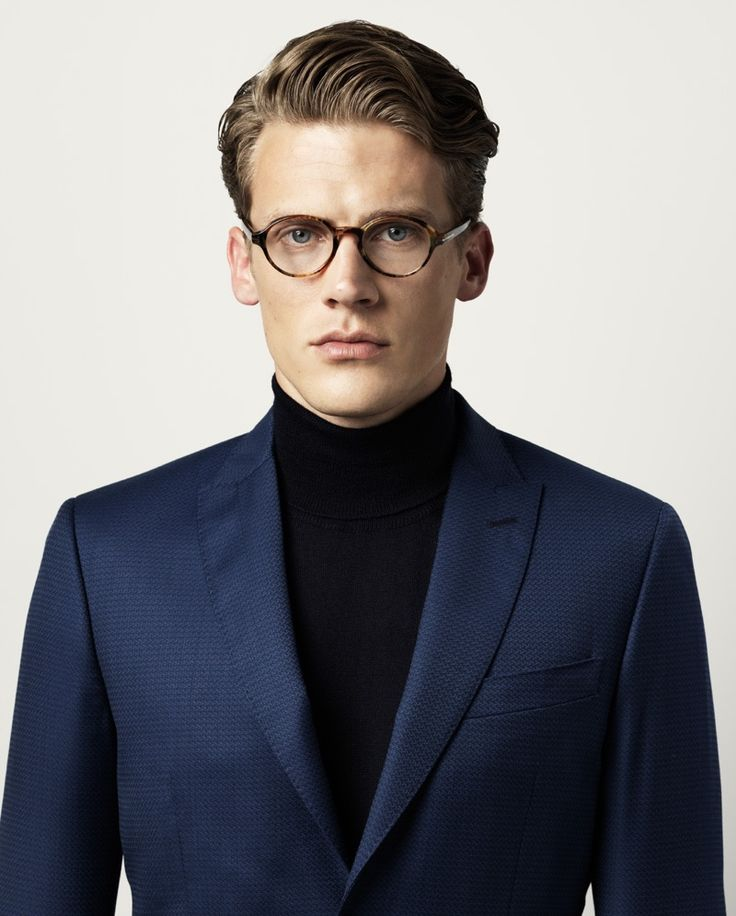 Jimmy wears blazer Marciano by Guess, turtleneck sweater Scapa, and glasses Tom Ford.