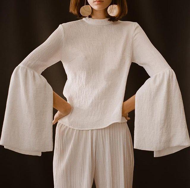Big billowing sleeves, natural linen white shirt.