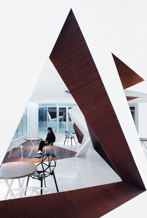 The Arthouse Café Designed Hong Kong Designer Joey Ho. It Is Triangular  Windows Pierce The Faceted Walls That Fold Around A Cafe In Hangzhou, China.