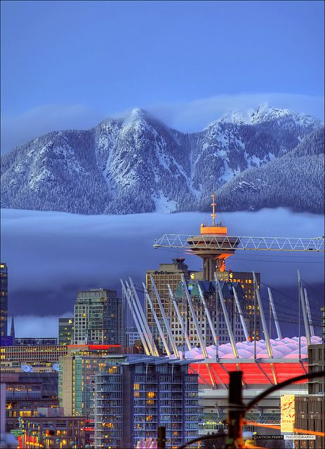 Downtown and North Shore Mountains. Vancouver, B.C., Canada. Photo by Clayton Perry. #Canada #travel #cities