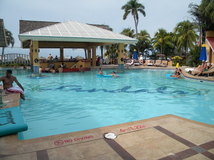 Main pool at Sandals Negril Beach Resort and Spa.  #sandals #beach #resort #Jamaica #caribbean #pool #honeymoon #travel #Negril #sunbathing #relaxing #couples