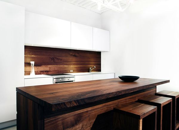 White kitchen wood island and splash back. (I'd put glass over that to keep it clean)