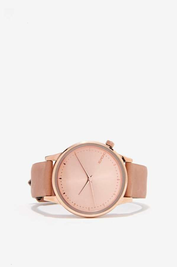 Komono Estelle Watch - You better watch it, ladies. The Estelle Watch has a genuine leather tan band and rose gold face with lustrous metal casing, stainless steel back, and water resistant case. $95 at Nasty Gal.