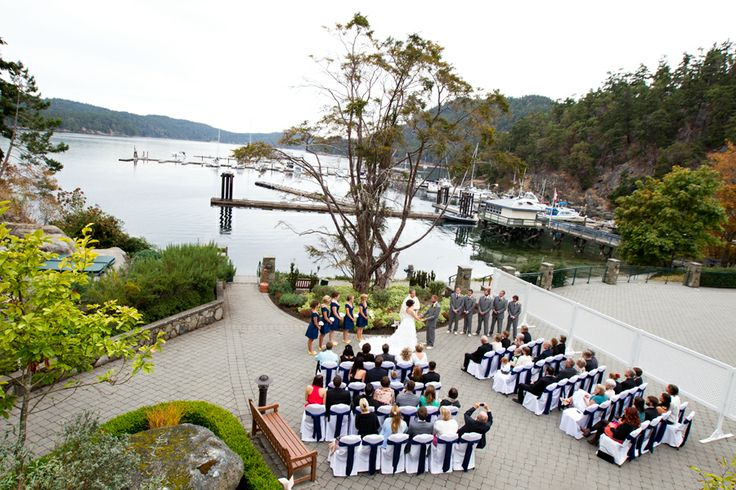 Oceanfront Terrace ceremony under the Yew at Poets Cove - Photographer Andrew Snucins