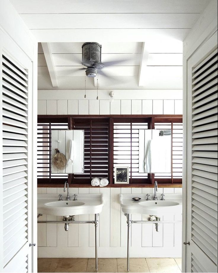 Custom made mirrors and teak shutters in the master bath the sinks and fttings are by volevatch barts home