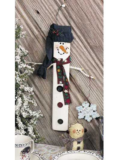 This silly snowman can be made in any size. I used a strip of wood called a barrel stave, but you could use a paint stick from the hardware or even make a miniature version with a craft stick.