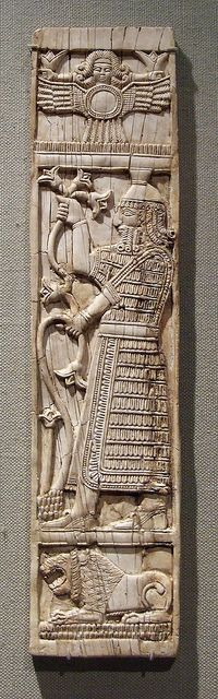 Sumer: Ivory Chairback Panel with a Warrior Holding Lotuses in the Metropolitan Museum of
