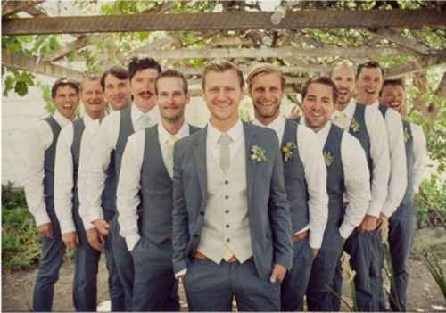 groomsmen in vests, groom in jacket