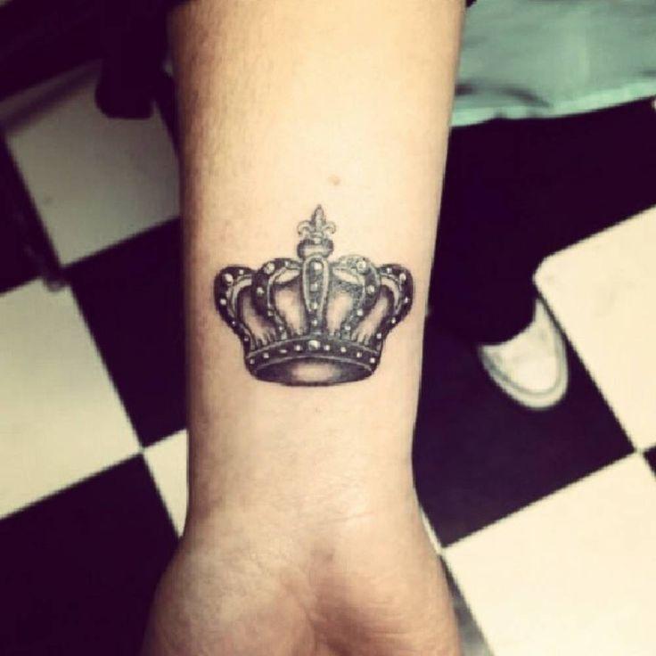 Wrist tattoo of a crown by Murat Bilek.