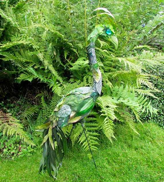 Camouflage Dragon Garden Art Flamingo -  handmade, recycled yard art, lawn sculpture, up-cycled plastic flamingo. via Etsy