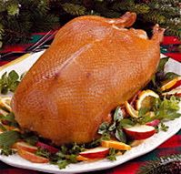 Roast Goose Recipe - Christmas Roast Goose Recipe.  An old, old tradition.  Drippings (abundant in a cooking goose) can be used to cook potatoes or saved in the fridge for another use.