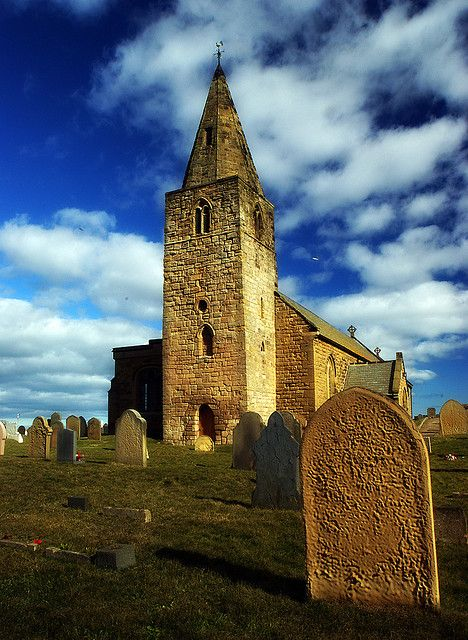 The beautiful ancient St Bartholomew's Church at Newbiggin in Northumberland England.
