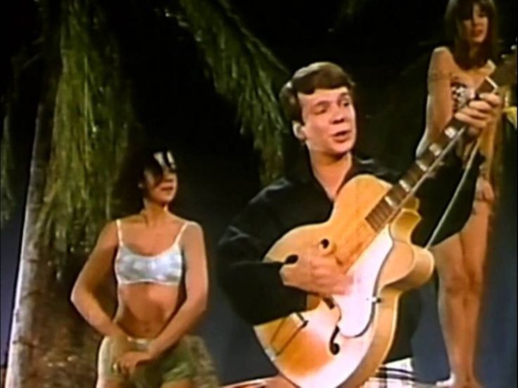 From 1962 here's Bobby Vee (of today's birthday celebrants) singing 'The Night Has A Thousand Eyes,' (and having a real groovy beach party it looks like!)