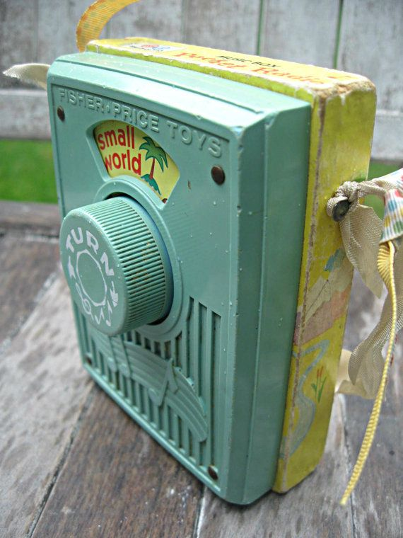 Vintage Fisher Price pocket radio, it's a small world, works great, jadeite and yellow on Etsy, $23.48 AUD