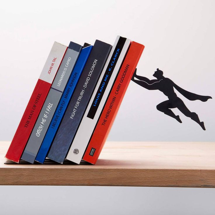 These fun metal bookshelves from Artori Design give the impression that a stealthy superhero is saving your books from certain doom. Lean your books against the specially angled shelf and watch your c