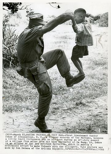 DANANG 1966 - MARINE IN VIETNAM PLAYS WITH CHILD   Flickr - Photo Sharing!