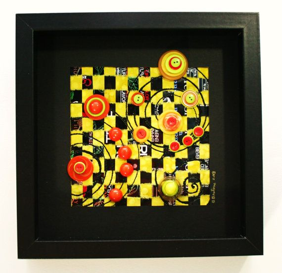 Yellow framed art of recycled metal and fabric Solar System I