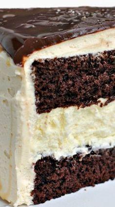 SALTED CARAMEL CHOCOLATE CHEESECAKE CAKE ==FOR THE CHEESECAKE== 2 pkg (8oz each) cream cheese, 2/3 c granulated sugar, pinch of salt, 2 large eggs, 1/3 c sour cream, 1/3 c heavy cream, 1 t vanilla ==FOR THE CAKE== 1 recipe chocolate layer cake (9inch layers)- homemade or cake mix is fine ==FROSTING== 1 c unsalted butter, 1/2 c caramel sauce, 4 c powdered sugar, 2 T milk, 1/2 t kosher salt ==THE GANACHE== 4 oz dark chocolate, 1/3 c heavy cream, 2 T caramel sauce, pinch kosher salt====