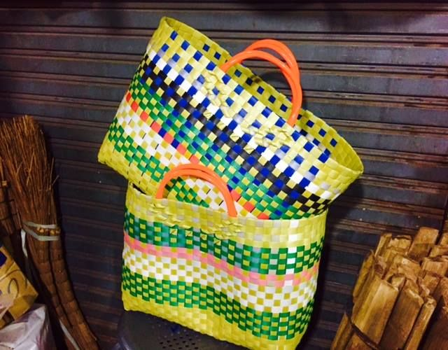 These wonderful baskets are 100% recycled and are hand woven  from multi-coloured, repurposed industrial packing tape. Tough and water resistant they are perfect  for shopping, the beach, work or play. They look great and are a brilliant re-use of what would otherwise be a waste product in landfill. As each bag is individually hand made no two are the same.