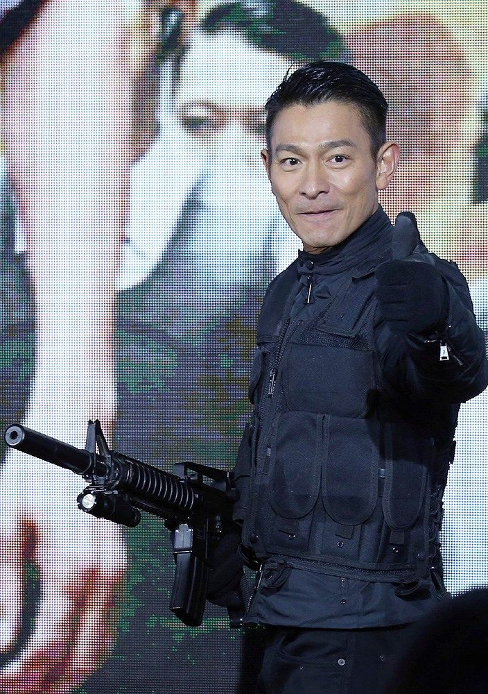 "Hong Kong actor Andy Lau continued the promotional tour for his new movie ""Firestorm"" in Beijing, China, November 19, 2013. He was joined by other actors Gordon Lam, Ray Lui and Michael Fitzereld Wong at the press conference."