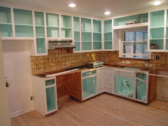 paint inside of cabinets fun bright color just for the idea its beautiful with glass doors and white kitchen