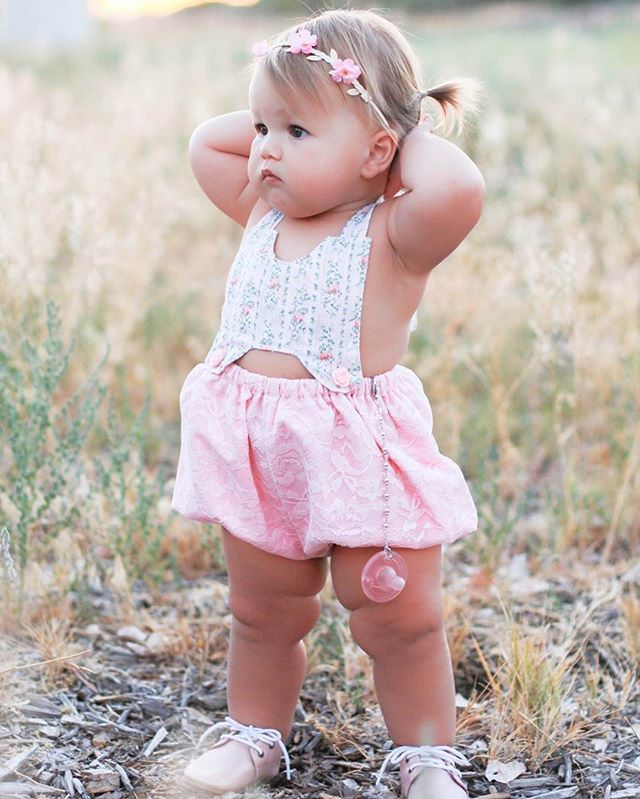 """Headband: @minitreschic - Use code """"KINSLEY15"""" for 15% off! Romper: @halobabyco - Use code """"friends of Kinsley"""" for 15% off! Pacifier clip: @templetonsilver - Use code """"KINSLEY"""" for 25% off! Shoes: @piperfinnfootwear - Use code """"JUST4U"""" for 30% off!"""