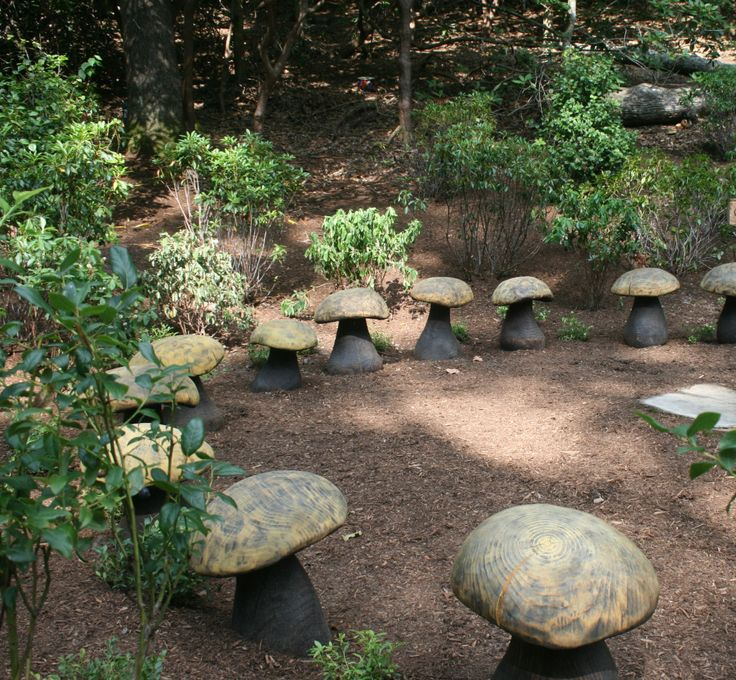 Naturalistic children's play space. Mushroom seats made by wood artist Barre Pinske.