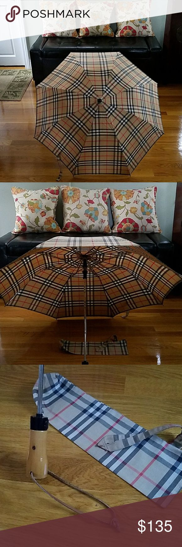 "Burberry Signature Classic Nova Check Umbrella This is an Authentic and Vintage Burberry folding umbrella with Cover. Good condition with very minor signs of use. It opens to 37"" across and closed folded position is 15"". Burberry Accessories Umbrellas"