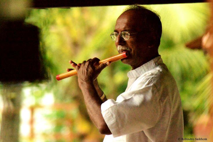 Welcoming with flute at Coconut Lagoon, Kumarakom.