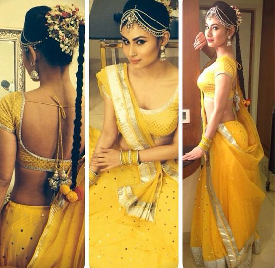 Mouni Roy is slaying this traditional look I'm sure you would want to steal for your haldi/choora ceremony! That yellow lehenga!  #IndianWedding #outfit #ideas | curated by Witty Vows - The ultimate guide for the Indian Bride | www.wittyvows.com