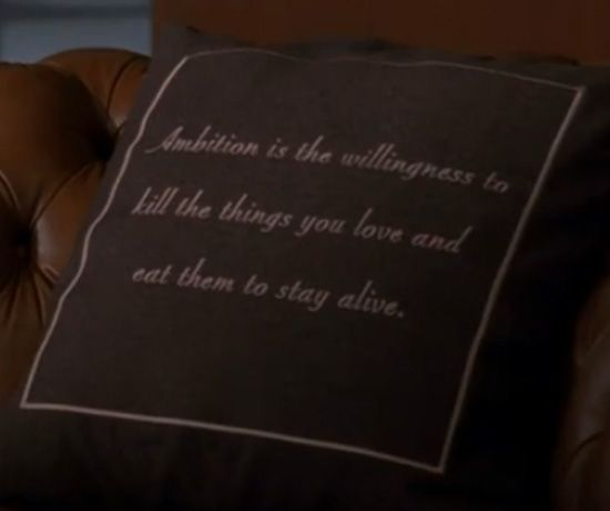 """Ambition is the willingness to kill the things you love and eat them in order to stay alive."" — Jack Donaghy's office throw pillow from 30 Rock"