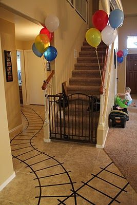 Use tape to make train tracks on the floor... My four year old nephew would LOVE this!! :-)